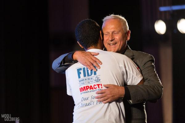 An Israeli veteran meets his FDIF IMPACT! Scholarship Sponsor.